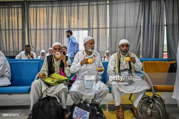 Kashmiri pilgrims drink tea as they wait for departure to the Holy city of Mecca at hajj house in Srinagar Indian administered Kashmir The first...
