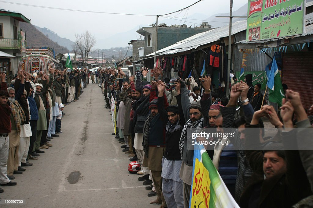 Kashmiri political and religious party Jamat-e-Islami activists take part in a rally to mark Kashmir Solidarity Day, near the Line of Control in Chakothi, about 60 km (36 miles) south of Muzffarabad, capital of Pakistan-administrated Kashmir on February 3, 2013. The Pakistani government declared February 5 a holiday to mark the day as Kashmir Solidarity Day and has organised rallies, seminars, photo exhibitions and placed banners across the country in support of Kashmir's right to self-determination. AFP PHOTO/Sajjad QAYYUM