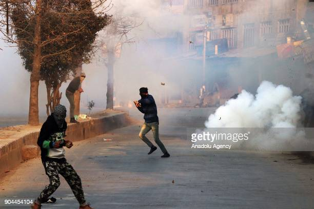 Kashmiri protester dodges as a stun grenade explodes in old city Srinagar the summer capital of Indian controlled Kashmir on January 13 2018...