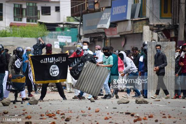 Kashmiri Protester holds a flag during the clashes in Srinagar Indian forces in Srinagar used teargas smoke canisters and bullets to disperse...