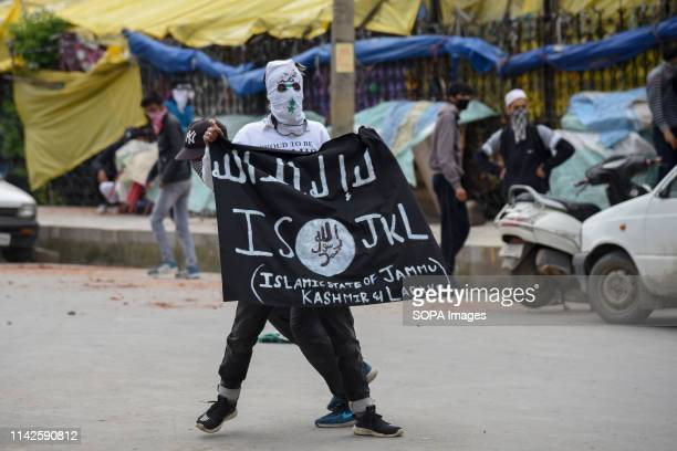 Kashmiri Protester seen holding an ISIS flag during the clashes after Friday prayers in Srinagar Government forces used tear smoke canisters and...