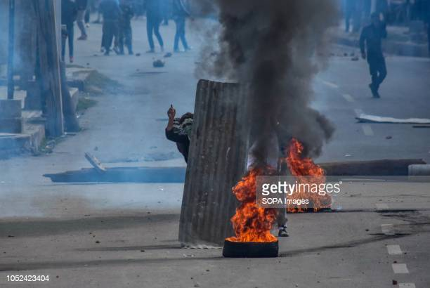 Kashmiri protester seen shouting pro freedom slogans amid tear gas smoke during clashes Clashes broke out between militants and government forces in...
