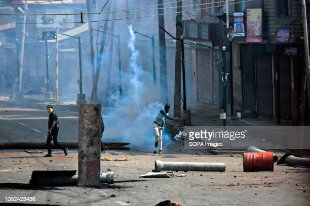 Kashmiri protester seen throwing a teargas canister back at the Indian government forces during clashes Clashes broke out between militants and...
