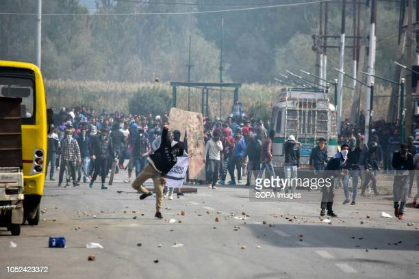 Kashmiri protester seen throwing stones at government forces during clashes Clashes broke out between militants and government forces in Srinagar The...