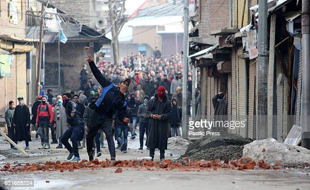 Kashmiri protester throw stones at government forces during Anti India demonstration in Sopore