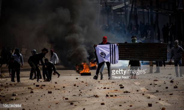 Kashmiri protesters clash with Indian government forces near the site after a gun battle between Indian government forces and Kashmiri rebels on...