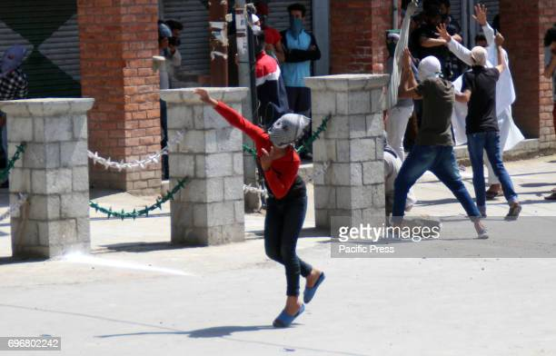 Kashmiri protesters clash with Indian police in Srinagar Police fired dozens of tear smoke shells and pellets to disperse protesters in downtown...