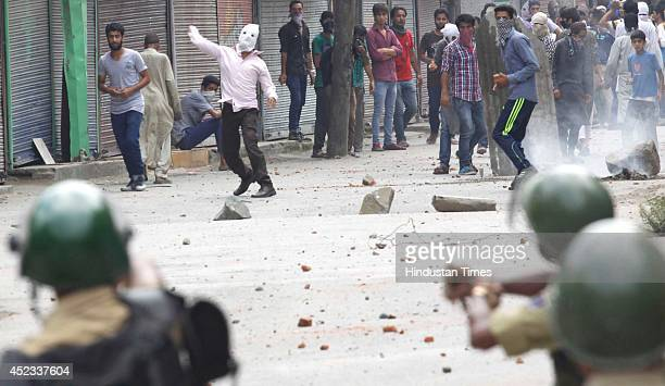 Kashmiri protesters clash with police during a protest against Israeli military operations in Gaza on July 18 2014 in Srinagar India The death toll...
