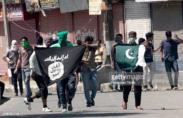 Kashmiri protesters displaying the flags of ISIS and Pakistan during a protest against alleged desecration of Jamia Masjid by police personnel...
