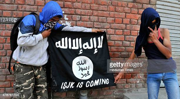 Kashmiri protesters displaying the flags of ISIS during a protest against alleged desecration of Jamia Masjid by police personnel yesterday after...