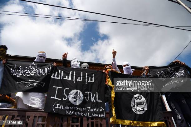 Kashmiri Protesters hold ISIS flags while making gestures during a protest in Srinagar Indian forces in Srinagar used teargas smoke canisters and...