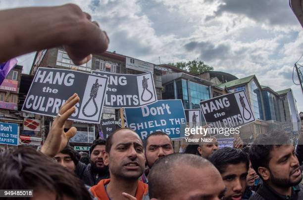 Kashmiri protesters hold placards as they shout 'death to rapists' during a protest against the rapeandmurder of a minor Muslim girl on April 21 2018...