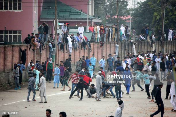 MANDI ANANTNAG JAMMU KASHMIR INDIA Kashmiri protesters pelting stones to the police officers and paramilitary soldiers after the culmination of...