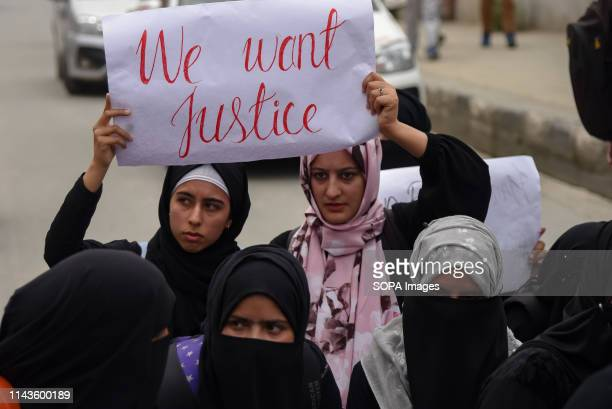 Kashmiri Protesters seen holding a placard during a protest against rape of three year old girl in Srinagar A massive protest was held in many parts...