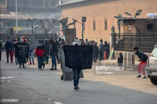 KASHMIR SRINAGAR JAMMU KASHMIR INDIA Kashmiri Protesters seen holding ISIS flags during the clashes with Indian forces Clashes erupted soon after...