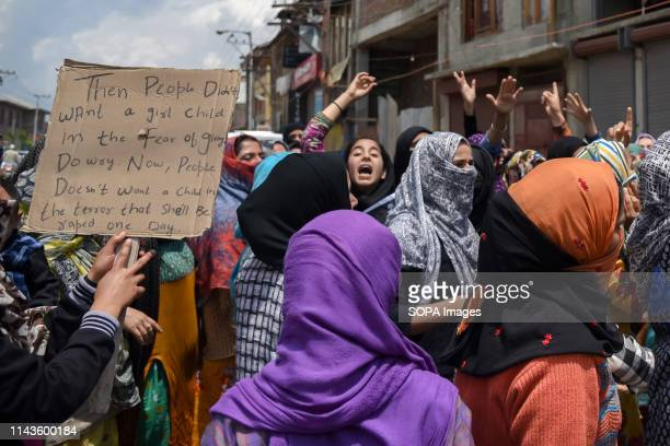 Kashmiri Protesters seen shouting slogans during a protest in Srinagar A massive protest was held in many parts of Kashmir valley against the alleged...