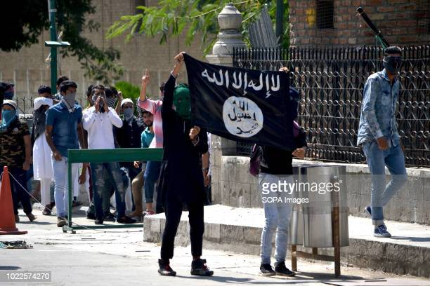 Kashmiri protesters seen with the ISIS flag during the clashes Clashes erupted after Friday Prayers between protesters and the Indian government...