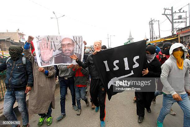 Kashmiri protesters shout profreedom slogans as they hold ISIS flag and Pakistani flag during a protest after Friday prayers in downtown of Srinagar...