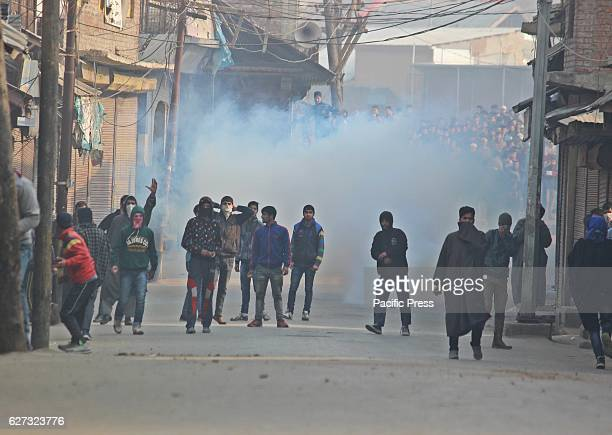 Kashmiri protesters shouting slogans amidst tear gas smoke during clashes Soon after Friday prayers people in large number assembled at Jamia Masjid...