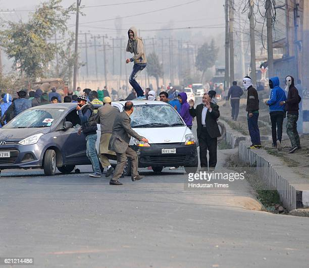 Kashmiri protesters smash windshields of private cars for ignoring separatistsponsored strike during a clash with police during the funeral...