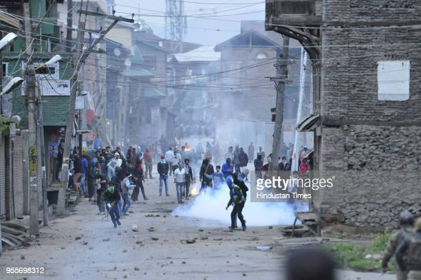 Kashmiri protesters throw stones at policemen during a protest against recent civilian killing on May 7 2018 in Srinagar India Authorities imposed...