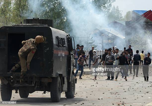 Kashmiri protesters throw stones towards an armoured Indian police van during an antiIndia demonstration in Narbal in the outskirts of Srinagar on...