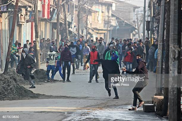 Kashmiri protesters throwing stones during clashes Soon after Friday prayers people in large number assembled at Jamia Masjid area of Sopore town...