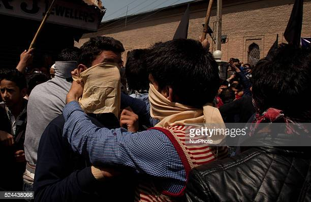 Kashmiri protesters tie masks on the faces during a protest on April 17 2015 in Srinagar the summer capital of Indian administered Kashmir India...