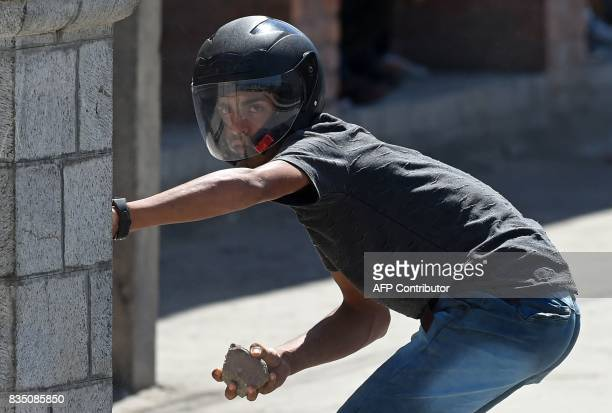 A Kashmiri protestor preparees to throw stones towards Indian government forces during clashes after Friday congregational prayers outside The Jamia...
