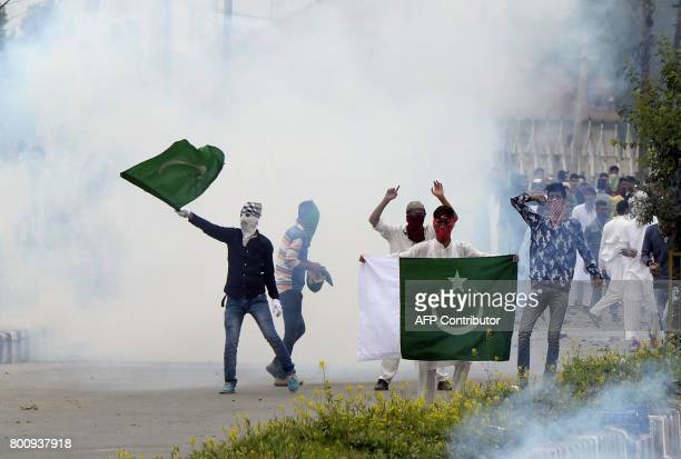 TOPSHOT Kashmiri protestors clash with Indian government forces after Eid prayers in downtown Srinagar on June 26 2017 The Islamic fasting month of...