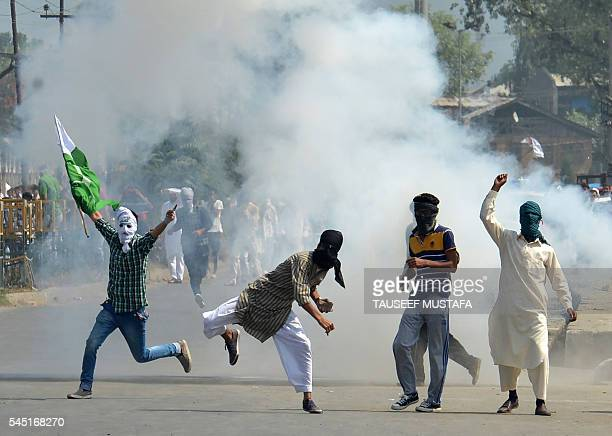 TOPSHOT Kashmiri protestors clash with Indian police as they took to the streets chanting profreedom slogans after prayers marking the festival of...