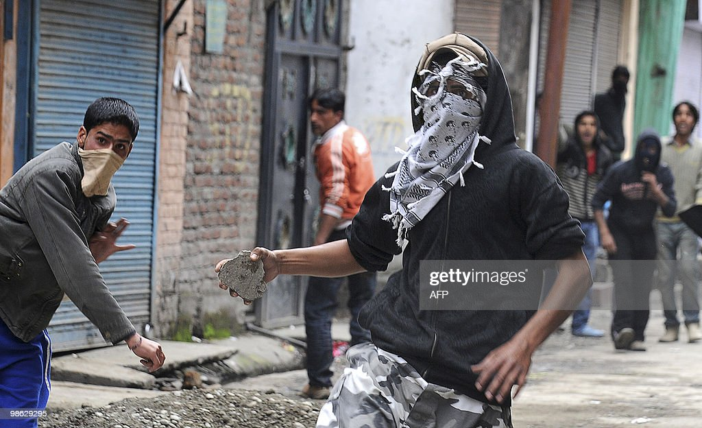 Kashmiri protestors clash with Indian police during a protest in Srinagar on April 23, 2010. Police detained activists including the chairman of Jammu and Kashmir Liberation Front (JKLF) Yasin Malik during a protest against death sentences handed to three members of a Kashmiri group that bombed a New Delhi market in 1996. Life in Indian Kashmir was crippled by a one-day strike to protest the death sentences. On April 13, one person was killed and 24 hurt during a strike called to protest the initial convictions for the bombing, which left 13 dead and dozens injured in New Delhi's Lajpat Nagar shopping area. Anti-India insurgents have waged a two-decade fight against rule by New Delhi in the Himalayan region that has left more than 47,000 people dead, according to the official count.Seperatists put the toll twice as high. AFP PHOTO/Tauseef MUSTAFA