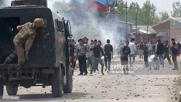 Kashmiri protestors hurl rocks and bricks to policemen during a protest against killing of a teenage student Suhail Ahmed Sofi at Narbal some 15...