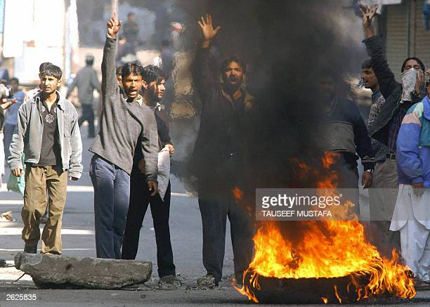 Kashmiri protestors shout antiIndian slogans 22 October 2003 during a protest against the arrest of influencial proindependence leader Yasin Malik in...