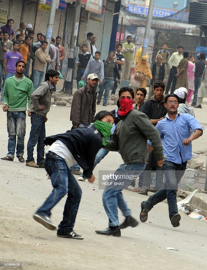 Kashmiri protestors throw stones at police during a protest in Srinagar on June 5, 2010. Police fired rubber bullets and teargas to quell hundreds of rock-throwing protesters who were angered as rumours spread of underwear being printed with a picture of the Al-Aqsa mosque, one of Islam's holiest shrines. AFP PHOTO/Rouf BHAT