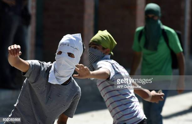 Kashmiri protestors throw stones towards Indian government forces during clashes after Friday congregational prayers outside The Jamia Masjid in...