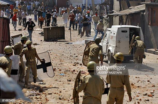 Kashmiri protestors throw stones towards Indian police in Srinagar on June 24 2008 Indian police fired teargas shells a second day as hundreds of...