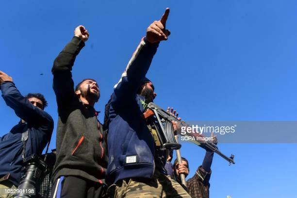 Kashmiri rebels are seen shouting pro freedom slogans as they attend the funeral of their comrade Sabzar Sofi a PhD scholar turned rebel in Sangam...