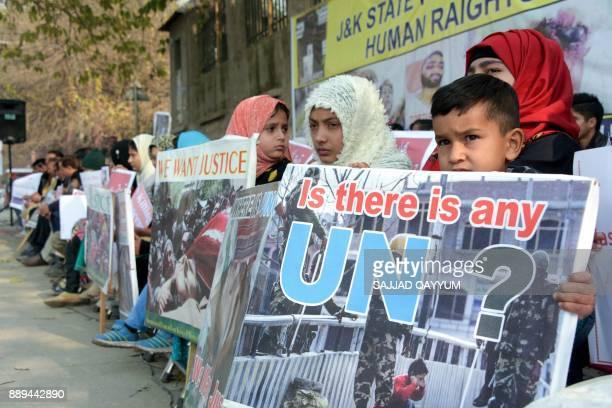 Kashmiri refugees protest in Muzaffarabad on December 10 as they commemorate the International Human Rights Day / AFP PHOTO / SAJJAD QAYYUM