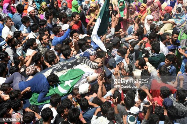 A Kashmiri relative of slain rebel Abid Ahmed wails over his body during his funeral procession in the village of Hajinar in the district Bandipora...