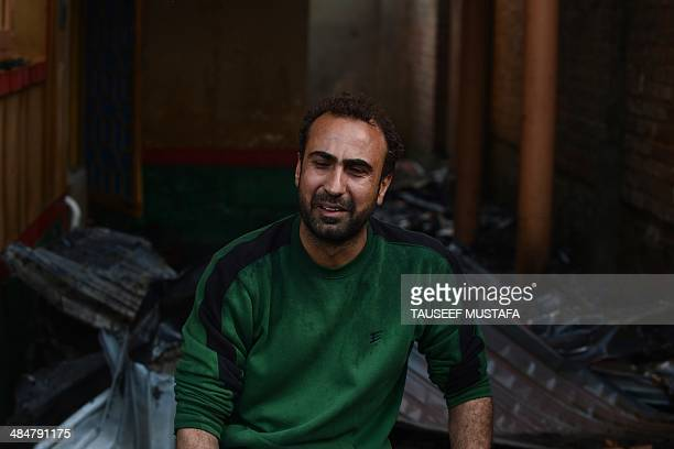 A Kashmiri resident reacts at the scene of his gutted house where Indian troops killed two militants in the outskirts of Srinagar on April 14 2014...