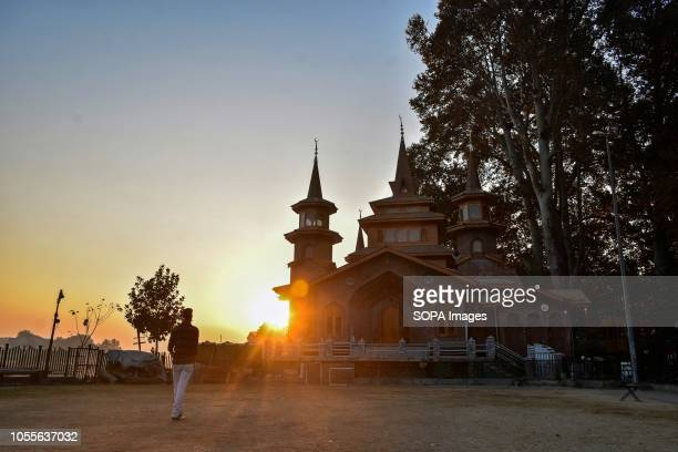 Kashmiri resident seen walking in the park at sunset on an autumn day in Srinagar Indian administered Kashmir Kashmir is the northernmost...