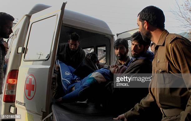 Kashmiri residents bring a man injured in a gun fight for treatment at a local hospital in Srinagar on February 14 2016 Two civilians were killed and...