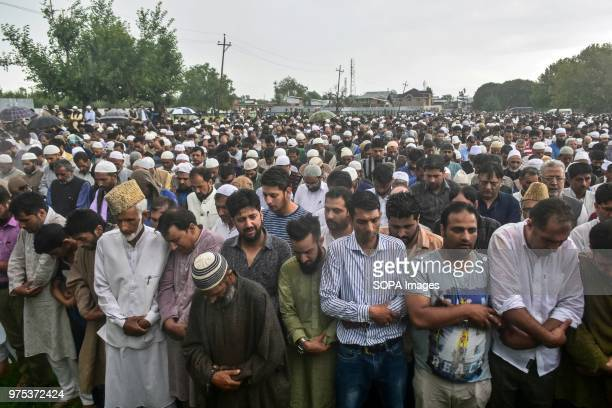 Kashmiri residents offer funeral prayers for Shujaat Bukhari veteran journalist and EditorinChief of English daily 'Rising Kashmir' in Kreeri some...