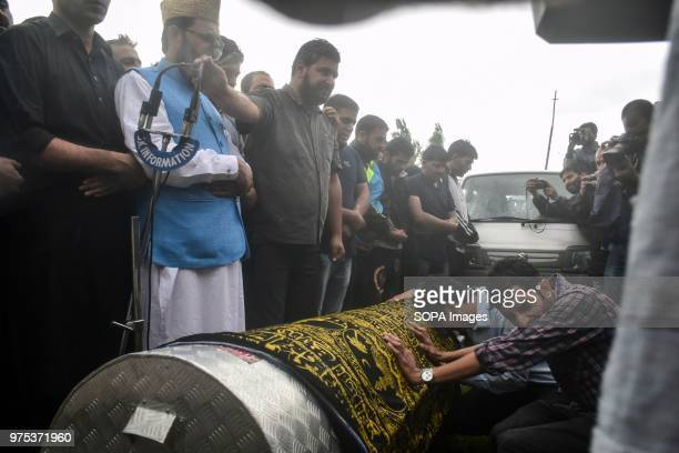 Kashmiri residents offer funeral prayers near the coffin of Shujaat Bukhari veteran journalist and EditorinChief of English daily 'Rising Kashmir' in...