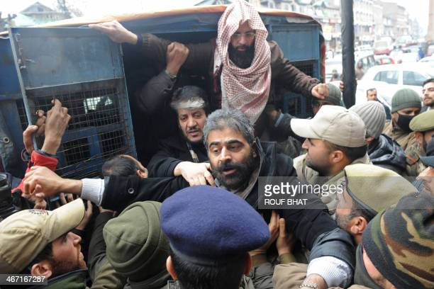 Kashmiri separatist leader Nayeem Khan is detained by Indian police following a meeting to protest last year's hanging of parliament attack convict...