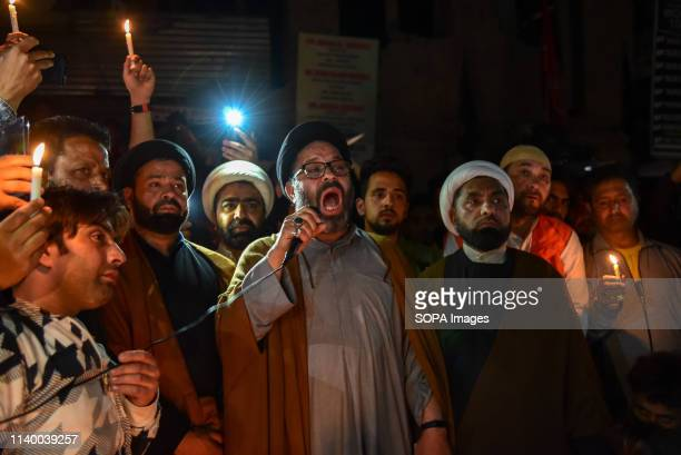 Kashmiri Shia Muslim cleric seen shouting slogans during a protest in Srinagar Shia protesters held a candle light vigil in Srinagar against the mass...