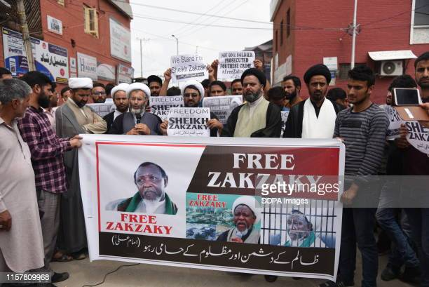 Kashmiri Shia Muslim demonstrators hold a banner during a protest in Srinagar Members of the Shia Community of Kashmir extended their support to...