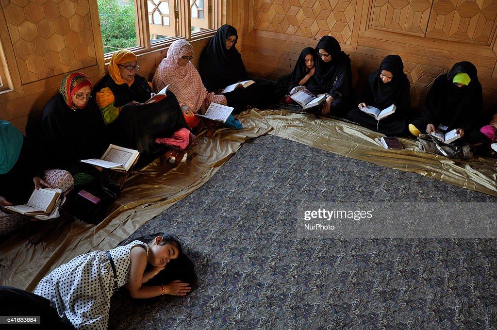 A kashmiri Shia Muslim Girl sleeps as others recite Quranic versus