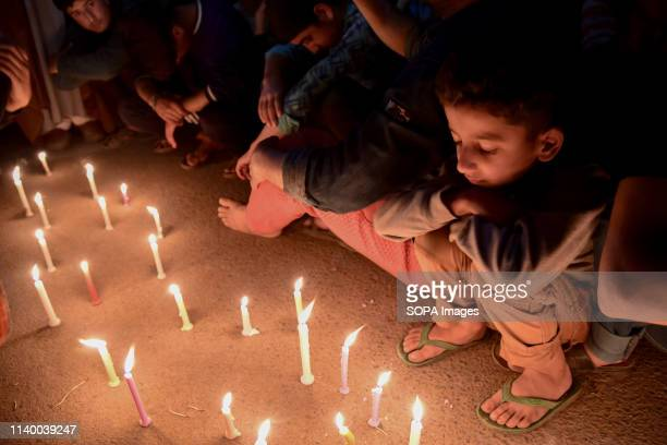 Kashmiri Shia Muslims seen lighting candles during a protest in Srinagar Shia protesters held a candle light vigil in Srinagar against the mass...
